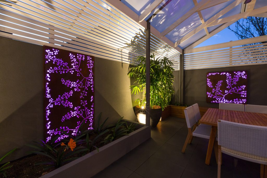 Lux Wall Lights, Lux Spot Lights and RGB Strip Lighting illumating Outdor Area and Backlit Screen